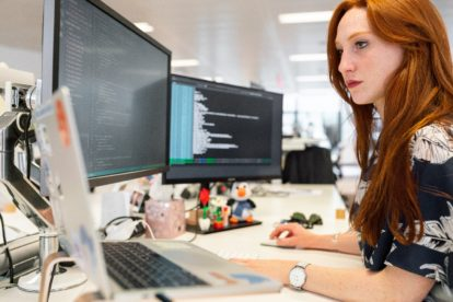 Java developer working on her desk.